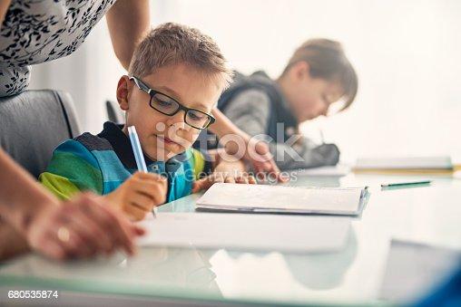 istock Kids doing homework 680535874