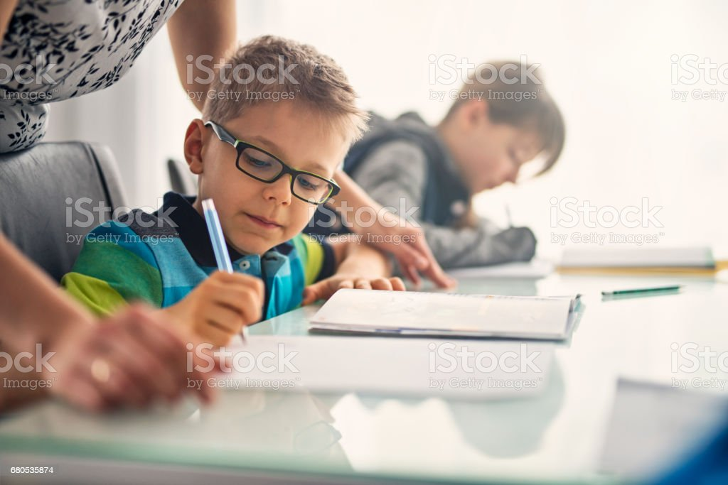 Kids doing homework stock photo