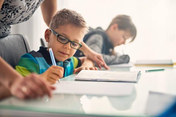 kids doing homework - homework stock photos and pictures