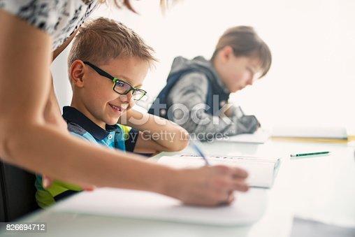862426824 istock photo Kids doing homework 826694712