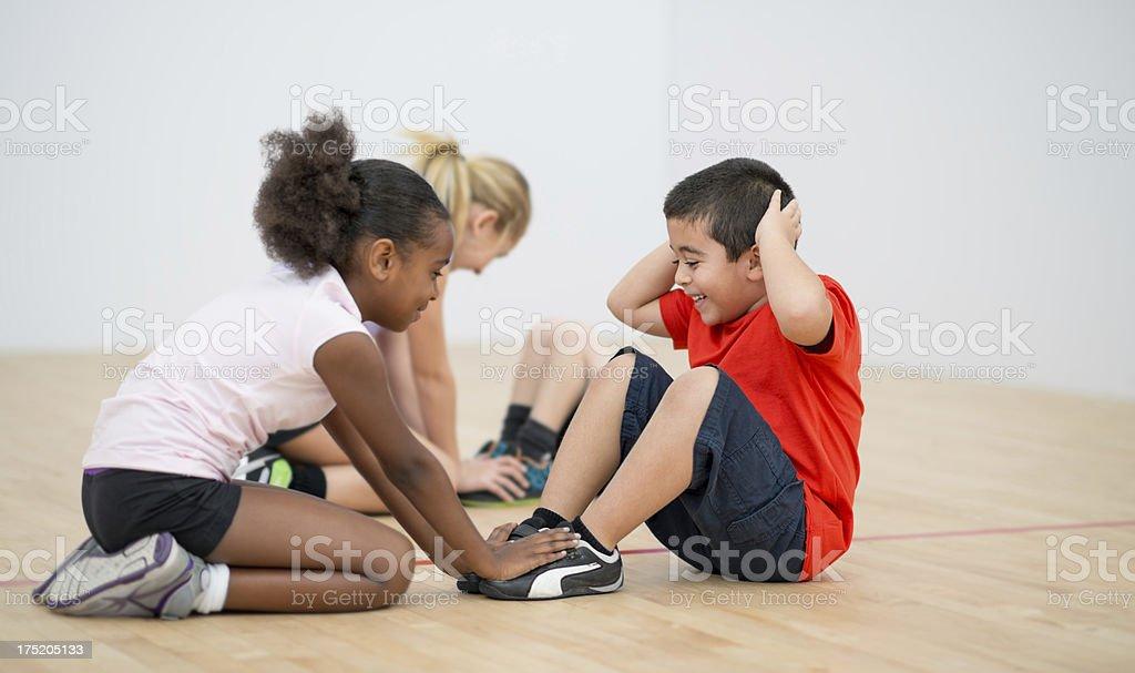 Kids doing sit ups royalty-free stock photo