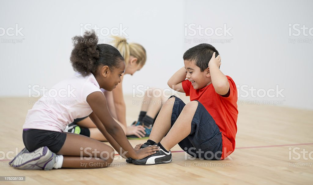 Kids doing sit ups stock photo