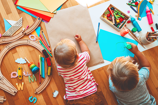istock Kids draw and make crafts. Background for preschool and kindergarten or art classes. 1173451698