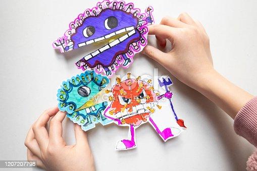 istock Kids drawing coronavirus 1207207798