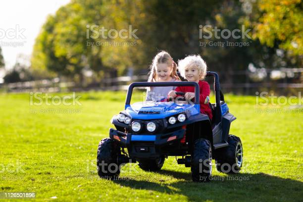 Kids driving electric toy car outdoor toys picture id1126501896?b=1&k=6&m=1126501896&s=612x612&h=otwzikpz1udkupozjoac9vm9nbpmfomyb3l7bcq37li=