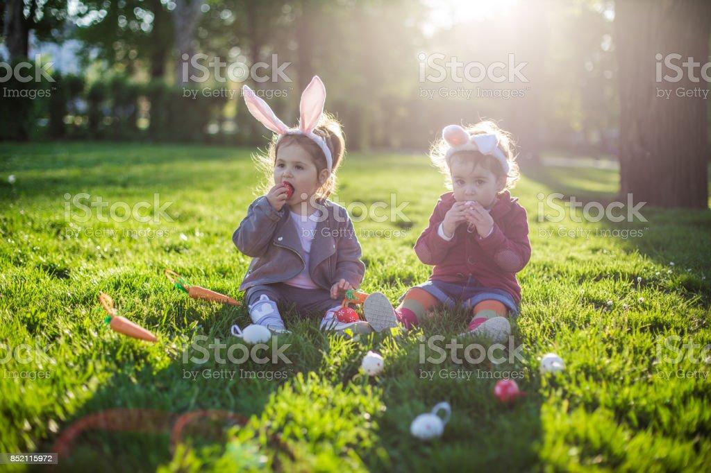 Kids eating easter eggs stock photo