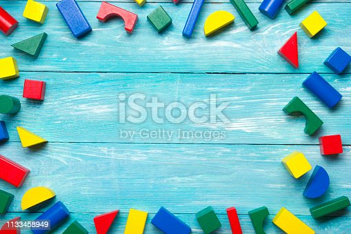 Kids educational developing toys frame on white background. Top view. Flat lay. Copy space for text.