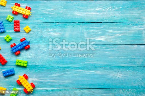 istock Kids educational developing toys frame on white background. Top view. Flat lay. Copy space for text 1137746651