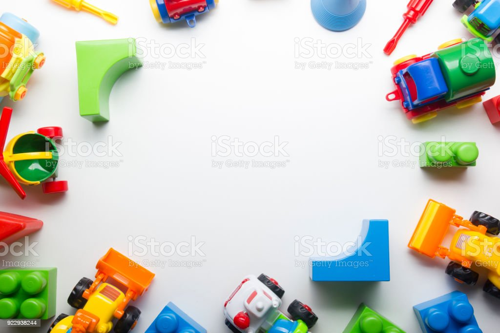 Kids educational developing toys frame on white background. Top view. Flat lay. Copy space for text stock photo