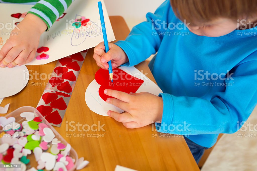 Kids engaged in Valentine's Day Arts with Hearts stock photo