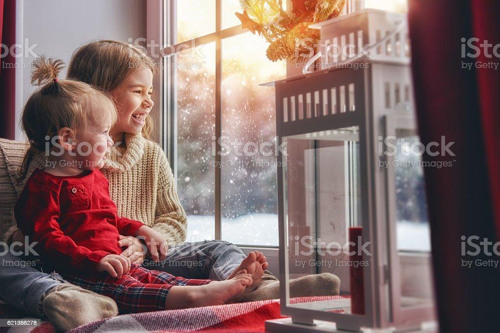 Kids enjoy the snowfall stock photo