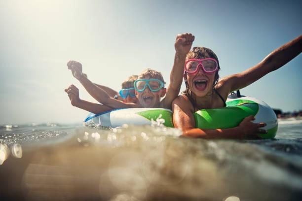 Kids enjoying beach and sea vacations picture id956187218?b=1&k=6&m=956187218&s=612x612&w=0&h=m7w0u8tgd9fsysqvhzcecmx8jnqjmhcwm9pcvghoer8=