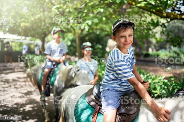 Kids enjoying riding ponies picture id1141389821?b=1&k=6&m=1141389821&s=612x612&h=ph5klcxlxbm tc8yaxh5zwfyxnthsnrjclferri1bm8=