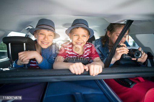 istock Kids enjoying road trip on sunny day 1150574878