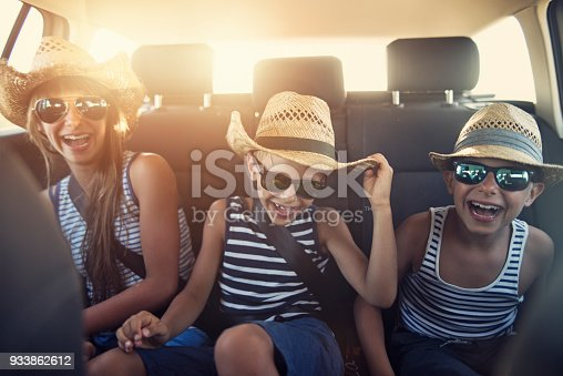 istock Kids enjoying road trip on sunny day 933862612
