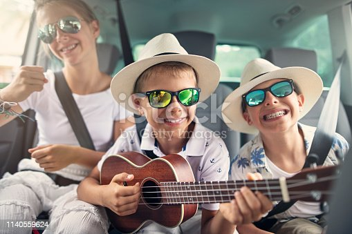 istock Kids enjoying road trip 1140559624