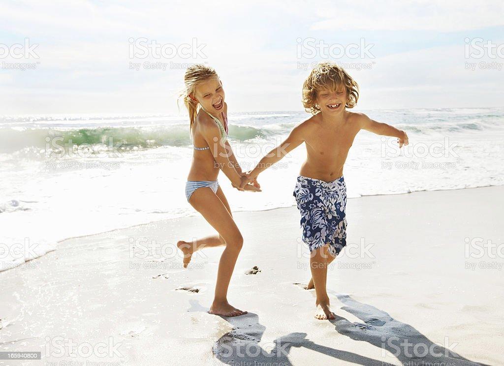 Kids enjoying summer vacation at the beach royalty-free stock photo