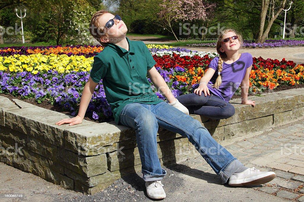 kids enjoying the sun stock photo