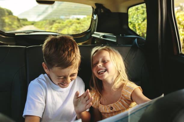 Kids enjoying while travelling by car stock photo