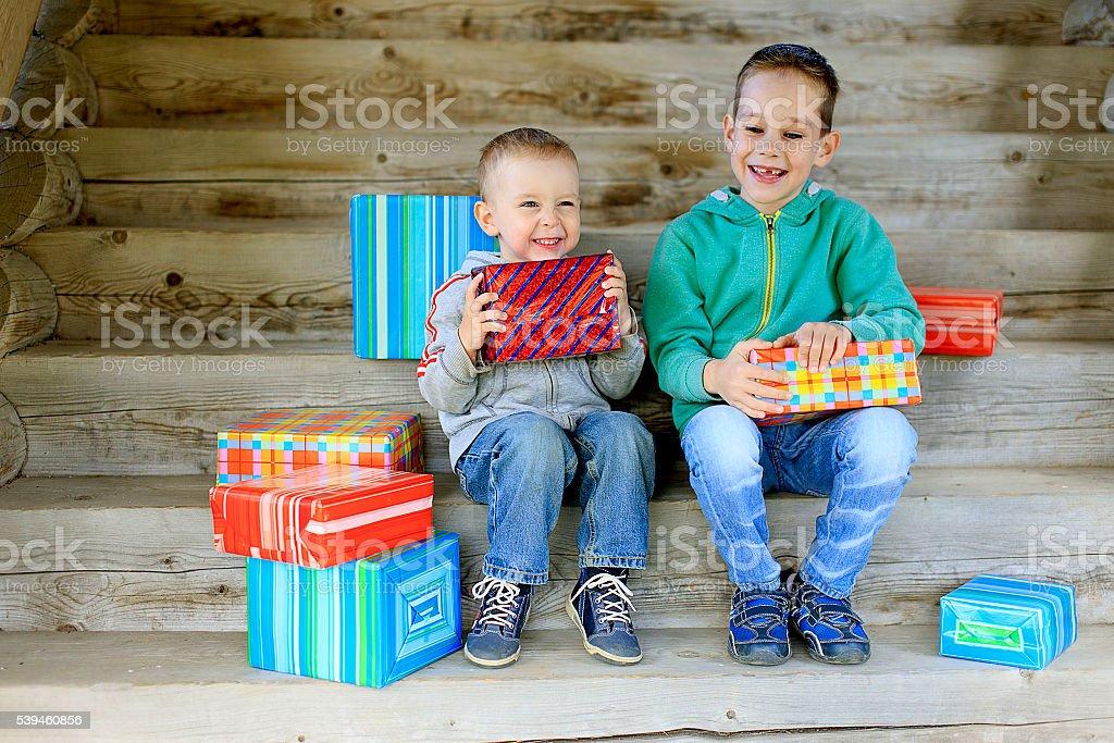 kids exchange gifts stock photo