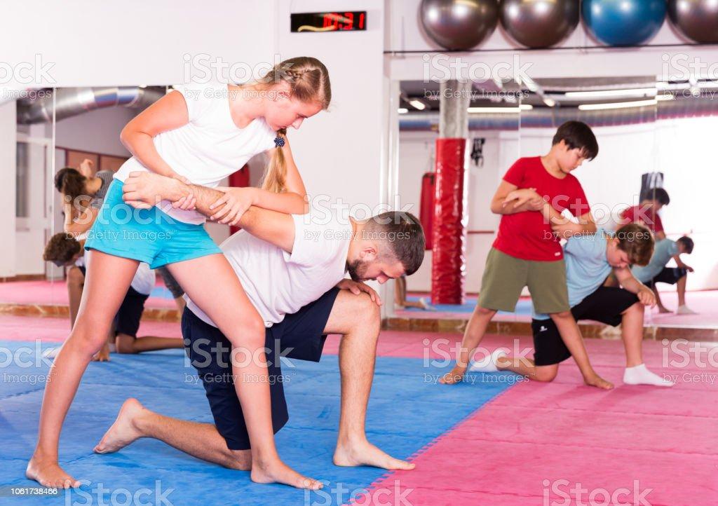 Kids exercising self-defense movements stock photo