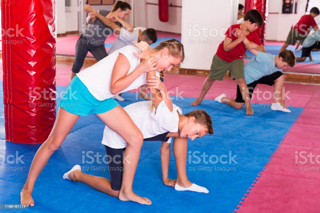 Mixed age group at self protection workout, training attack movements...
