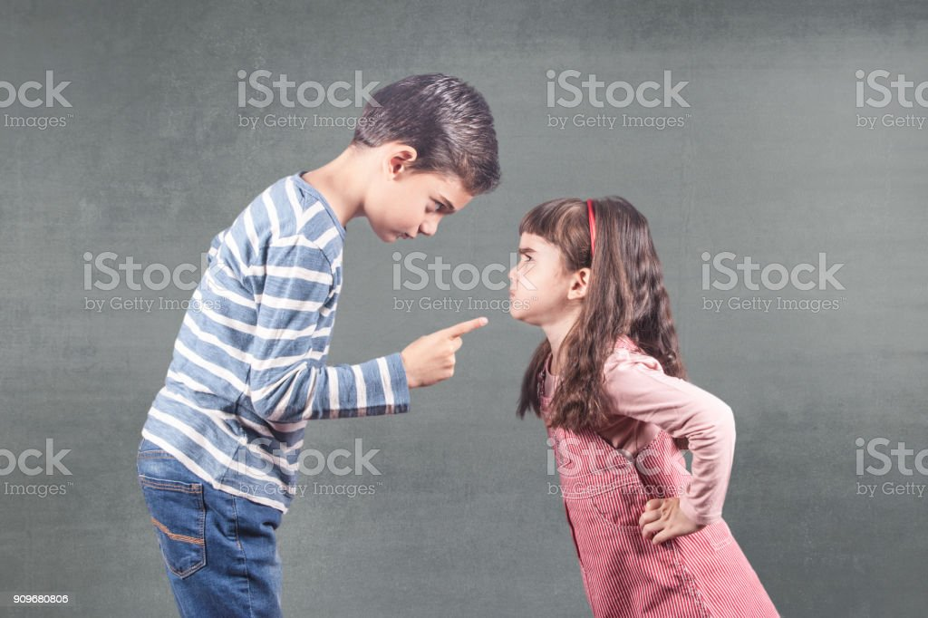 Kids fighting. Family issues concept stock photo