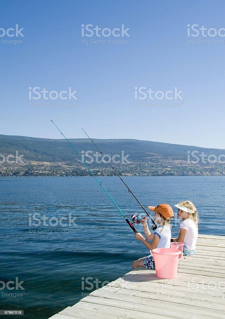 Kids fishing in lake royalty-free stock photo