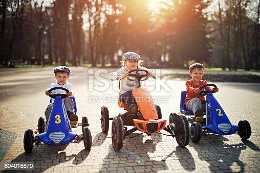 1035136022 istock photo Kids getting ready to retro go-kart race 604018870