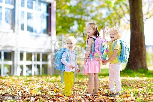 istock Kids go back to school. Child at kindergarten. 1165010905