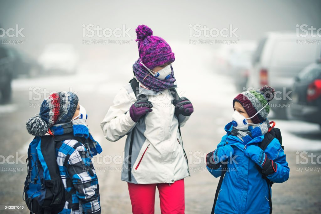 Kids going to school in the smog stock photo