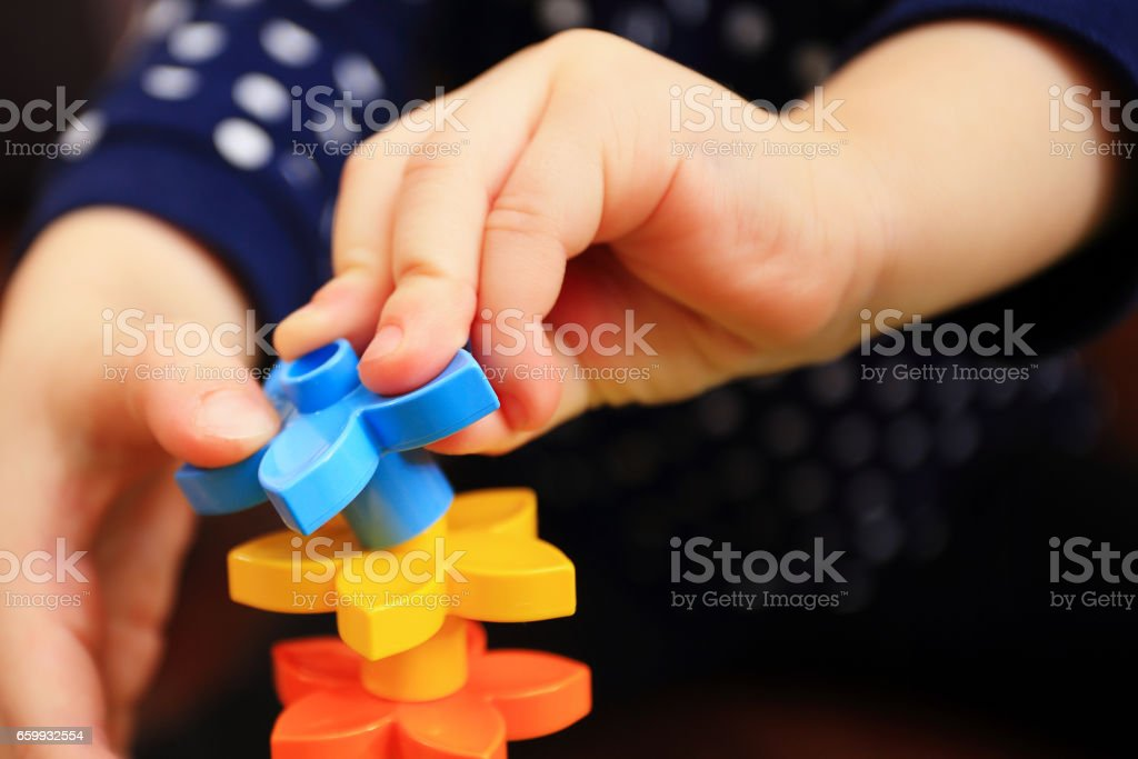 Kids hand with constructor stock photo