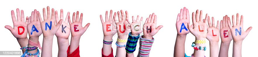 516544386 istock photo Kids Hands Holding Danke Euch Allen Means Thank You All, Isolated Background 1220401895