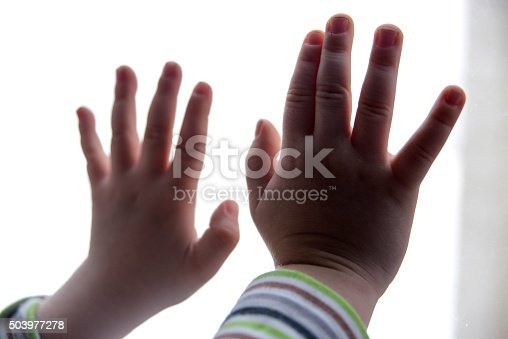 istock Kid's Hands On Window 503977278