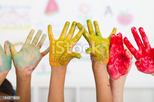 154371635 istock photo kids hands paint 154371635