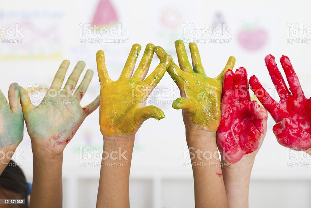 kids hands paint stock photo