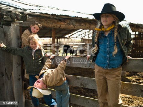 Young cowboys and cowgirls hanging out at corral