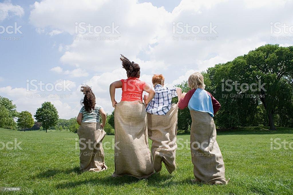 Kids having a sack race stock photo
