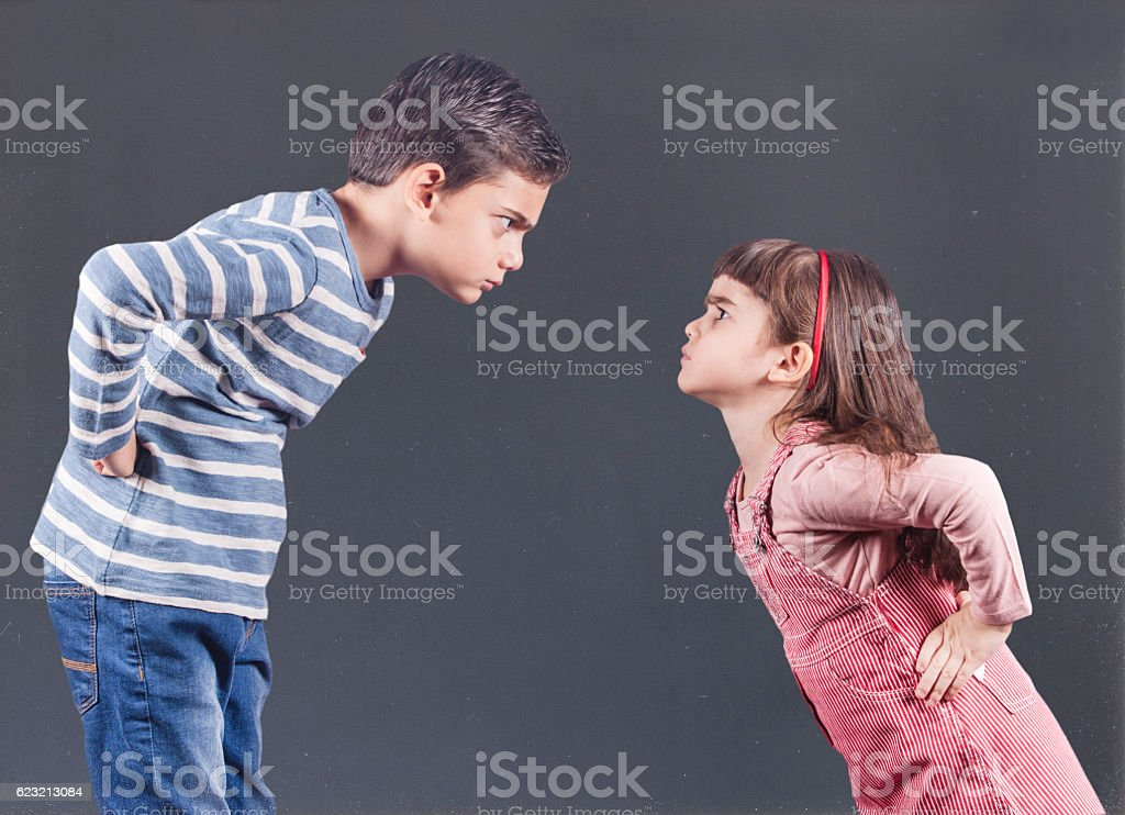 Kids having an argument stock photo