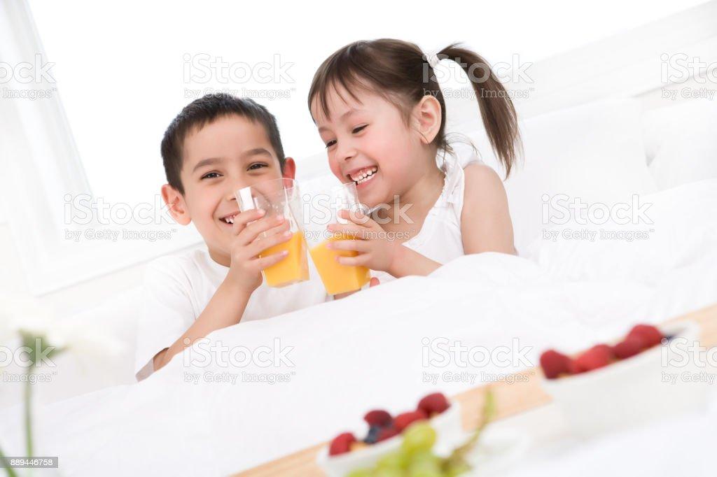 Kids Having Breakfast In Bed Stock Photo Download Image Now Istock