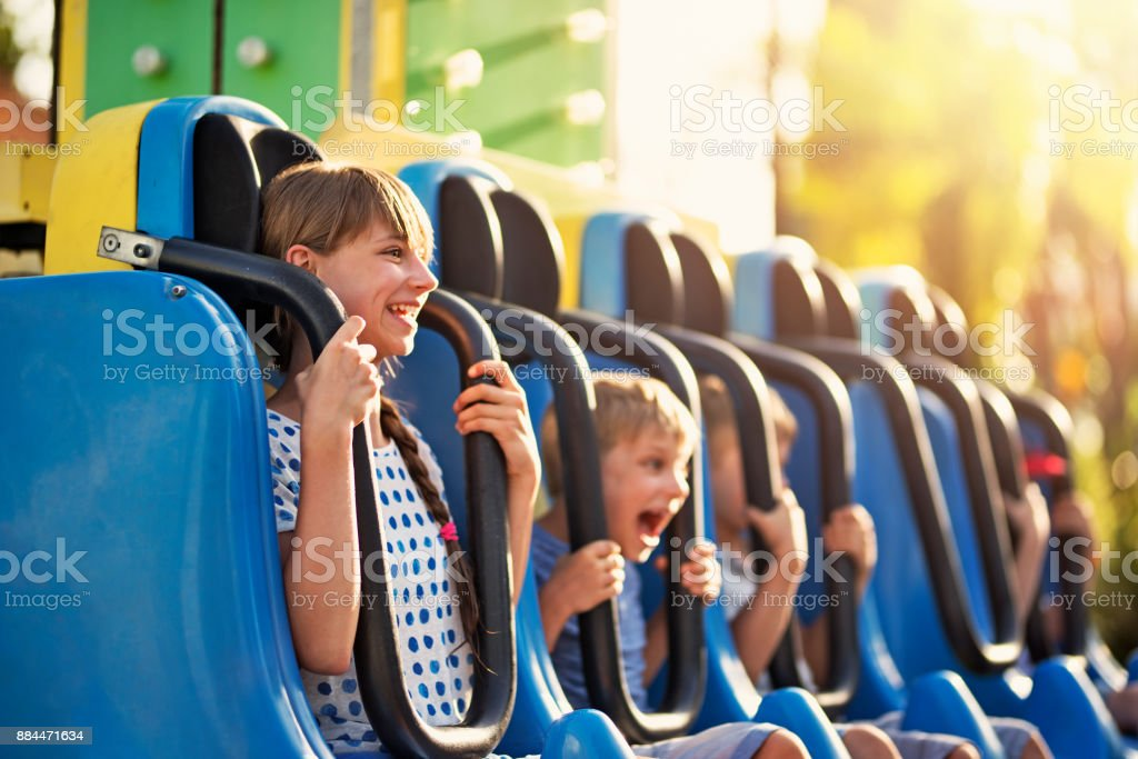 Kids having extreme fun in amusement park drop tower stock photo