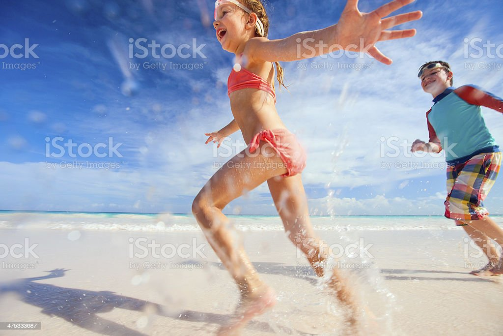 Kids having fun at beach stock photo