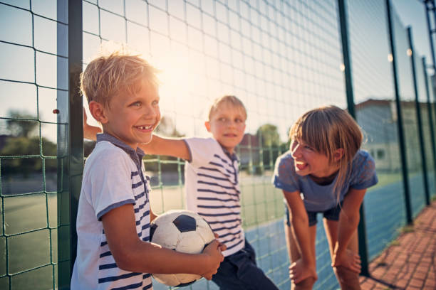 kids having fun at the schoolyard - recess stock photos and pictures