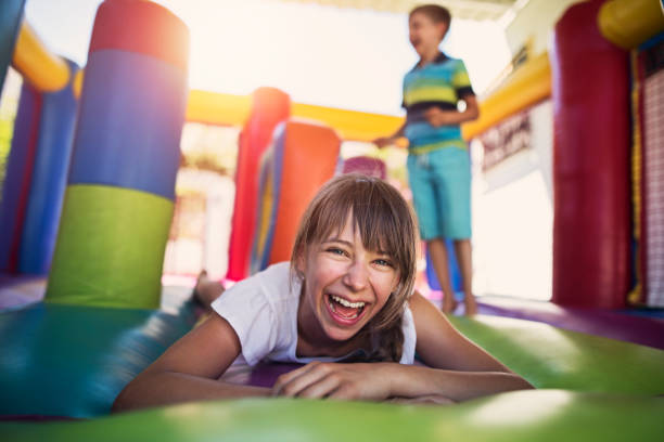 Kids having fun in inflatable castle playground stock photo