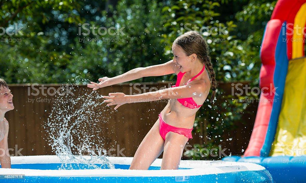 Kids Having Fun In Pool stock photo