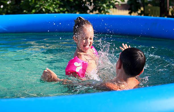 Kids having fun in the swimming pool stock photo