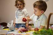 Kids having fun painting easter eggs