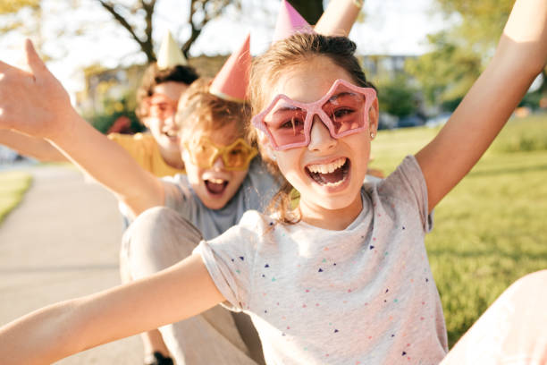 kids having fun - excited emoji stock photos and pictures