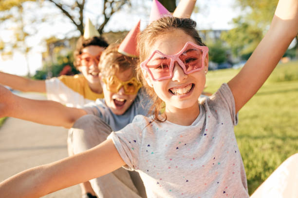 Kids having fun Birthday party celebration 12 13 years stock pictures, royalty-free photos & images