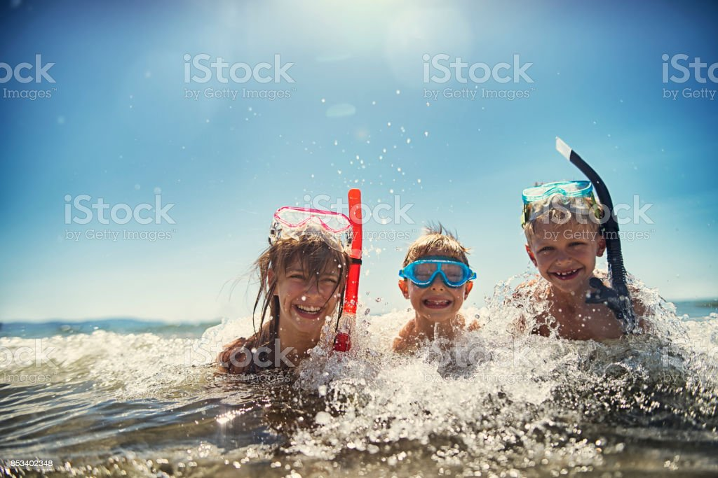 Kids having fun snorkeling in beautiful sea stock photo